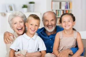 Happy Young Siblings With Their Grandparents
